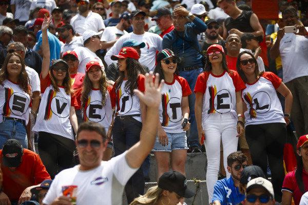Young female fans of Sebastian Vettel, Ferrari.