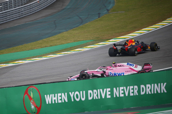 Esteban Ocon, Force India VJM11 Mercedes, spins off after colliding with race leader Max Verstappen, Red Bull Racing RB14 Tag Heuer.