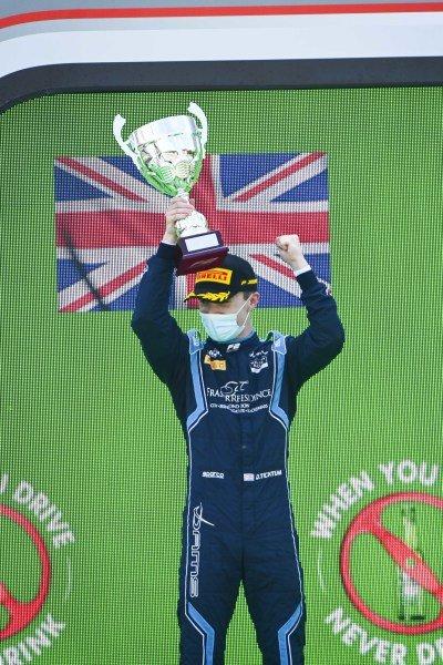 Race Winner Dan Ticktum (GBR, DAMS) celebrates on the podium with the trophy