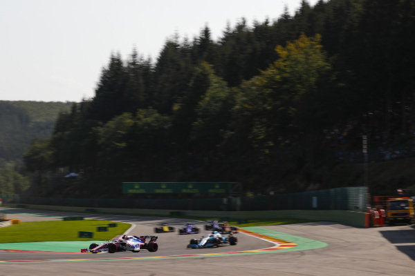Lance Stroll, Racing Point RP19, leads George Russell, Williams Racing FW42 and a gaggle of cars