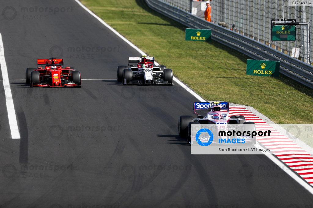 Lance Stroll, Racing Point RP19, leads Antonio Giovinazzi, Alfa Romeo Racing C38, and Sebastian Vettel, Ferrari SF90