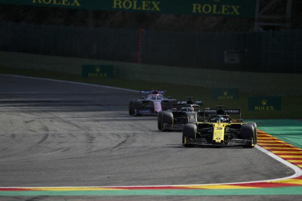 Daniel Ricciardo, Renault R.S.19, leads Romain Grosjean, Haas VF-19, and Sergio Perez, Racing Point RP19