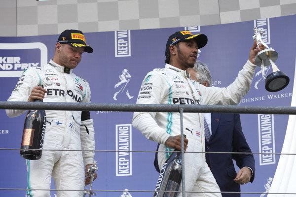 Valtteri Bottas, Mercedes AMG F1, 3rd position, and Lewis Hamilton, Mercedes AMG F1, 2nd position, leave the podium