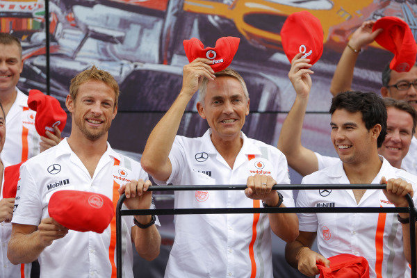 (L to R): Jenson Button (GBR) McLaren; Martin Whitmarsh (GBR) McLaren Chief Executive Officer; Sergio Perez (MEX) McLaren and the McLaren team celebrate their 50th anniversary in front of their Communications Centre in the Monza paddock. Formula One World Championship, Rd12, Italian Grand Prix, Race, Monza, Italy, Sunday 8 September 2013.  BEST IMAGE