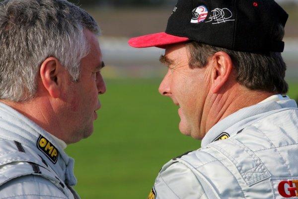 (L-R): Derek Warwick (GBR) talks with Nigel Mansell (GBR). Grand Prix Masters Testing, Day One, Silverstone, England, 26 October 2005. DIGITAL IMAGE