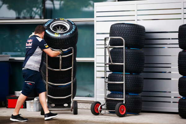 Shanghai International Circuit, Shanghai, China.  Thursday 06 April 2017. A Red Bull team member wheels a stack of Pirelli tyres. World Copyright: Andy Hone/LAT Images ref: Digital Image _ONY3426