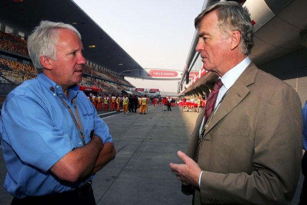 (L to R): Charlie Whiting (GBR) FIA Delegate talks with Max Mosley (GBR) FIA President. Formula One World Championship, Rd19,  Chinese Grand Prix, Race Day, Shanghai, China, 16 October 2005. DIGITAL IMAGE