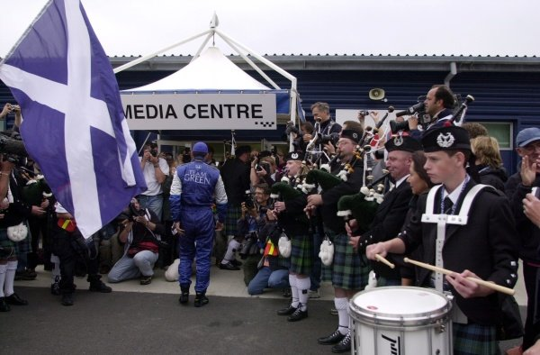 Bagpipers welcome race winner Dario Franchitti into the media center after his hard fought victory at the Rockingham 500.  Rockingham Motor Speedway, Corby, GBR.  14  Sept., 2002. CC15B