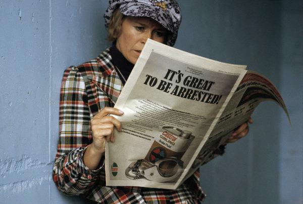 Anita Elford reads a newspaper.
