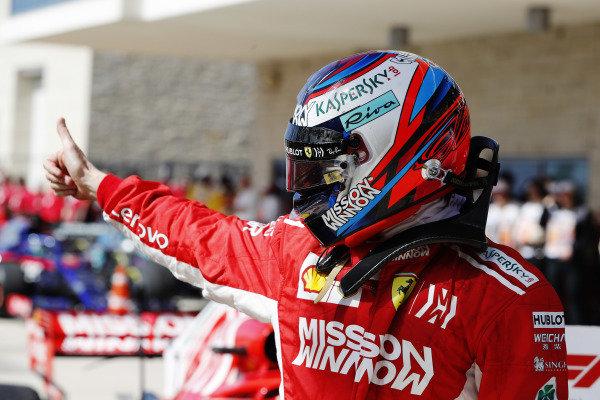 Kimi Raikkonen, Ferrari, gives a thumbs up as he celebrates after winning the race