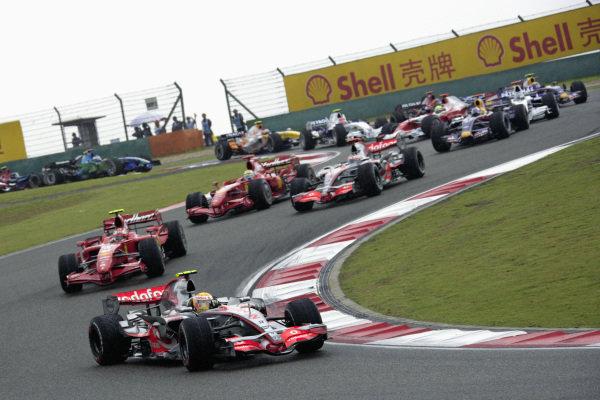 Lewis Hamilton, McLaren MP4-22 Mercedes leads Kimi Räikkönen, Ferrari F2007 as Felipe Massa, Ferrari F2007 and Fernando Alonso, McLaren MP4-22 Mercedes battle for position behind at the start.