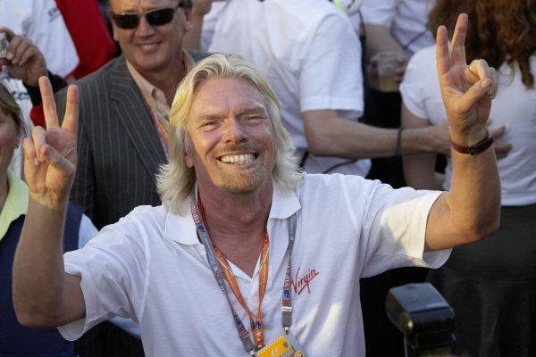 Brawn GP sponsor and Virgin owner Richard Branson enjoys the podium ceremony.