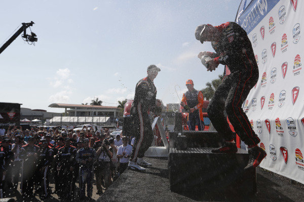 Josef Newgarden, Team Penske Chevrolet, Will Power, Team Penske Chevrolet, Scott Dixon, Chip Ganassi Racing Honda celebrate with champagne on the podium