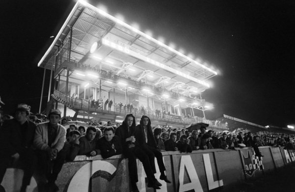 Fans continue to watch the action during the night.
