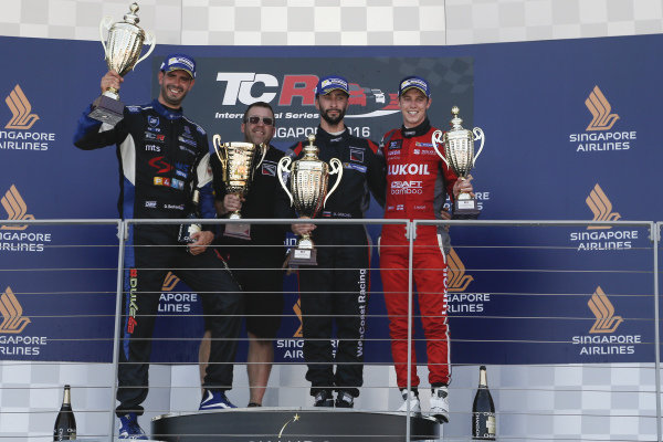 (L to R): Second placed Dusan Borkovic (SRB) B3 Racing Team, race winner Mikhail Grachev (RUS) WestCoast Racing and third placed at James Nash (GBR) Team Craft-Bamboo celebrate on the podium with the trophies at TCR International Series, Rd9, Marina Bay Street Circuit, Singapore, 16-18 September 2016.