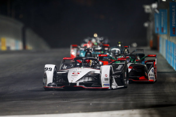 Pascal Wehrlein (DEU) Tag Heuer Porsche, Porsche 99X Electric, leads Sebastien Buemi (CHE) Nissan e.Dams, Nissan IMO2