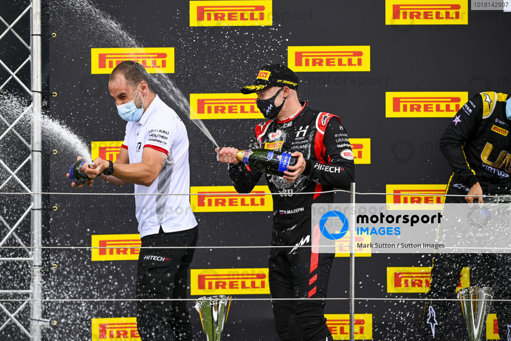 Nikita Mazepin (RUS, HITECH GRAND PRIX), 1st position, sprays the victory Champagne on the podium