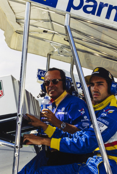 Cesare Fiorio and Pedro Diniz on the Ligier pitwall.