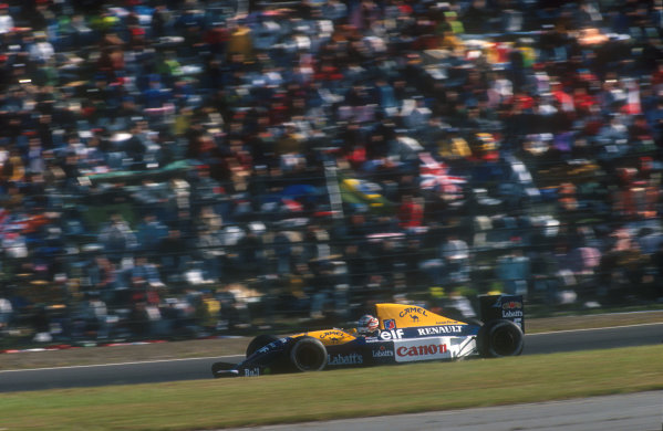 1991 Japanese Grand Prix.Suzuka, Japan.18-20 October 1991.Nigel Mansell (Williams FW14 Renault) retired from the race after spinning off at First Curve. He had been right behind Senna into First Curve, lost a bit of downforce and ran wide over the kerb putting him into the gravel. His brakes had also given him a problem most of the weekend.Ref-91 JAP 11.World Copyright - LAT Photographic