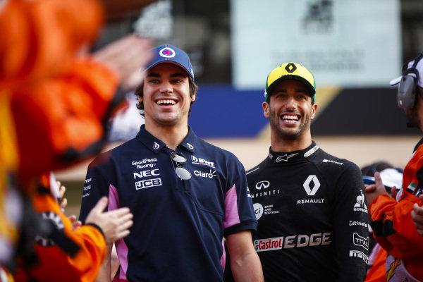 Lance Stroll, Racing Point, and Daniel Ricciardo, Renault F1 Team