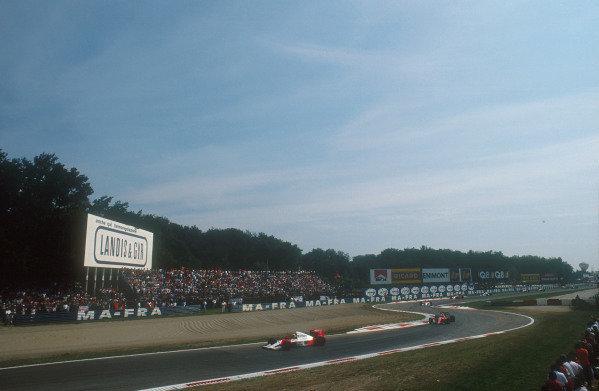 1990 Italian Grand Prix.Monza, Italy.7-9 September 1990.Ayrton Senna (McLaren MP4/5B Honda) leads Alain Prost (Ferrari 641), Gerhard Berger (McLaren MP4/5B Honda), Nigel Mansell (Ferrari 641) and Jean Alesi (Tyrrell 019 Ford) through the Rettifilo Chicane early on.Ref-90 ITA 15.World Copyright - LAT Photographic