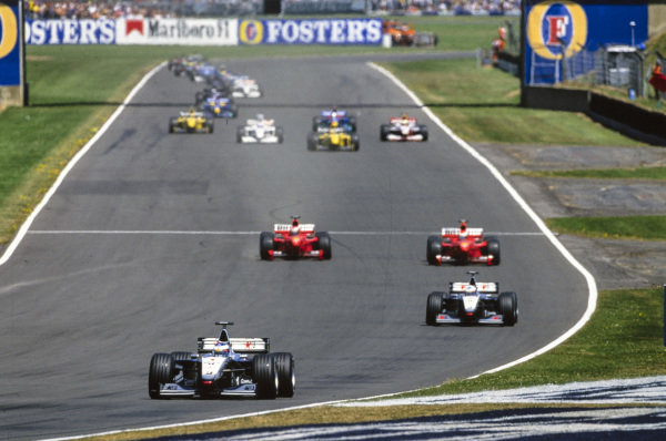 Mika Häkkinen, McLaren MP4-14 Mercedes, leads David Coulthard, McLaren MP4-14 Mercedes, Michael Schumacher, Ferrari F399, Eddie Irvine, Ferrari F399, and the rest of the field at the start of the race.