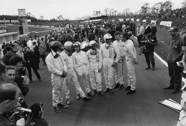 Brands Hatch, England. 12th March 1967.L to R: Dan Gurney, Jack Brabham, Bruce McLaren, Richie Ginther, Denny Hulme, Jochen Rindt and Graham Hill share a joke on the grid before the start of the race, portrait.World Copyright: LAT Photographic.Ref: 1500 - 40A/41.