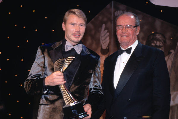 Grosvenor House Hotel, Park Lane, London. 5th December 1999. Mika Hakkinen receives an award from actor James Garner, portrait. World Copyright: Jeff Bloxham/LAT Photographic