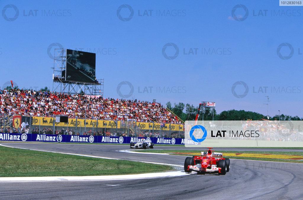 2004 San Marino Grand Prix.Imola, Italy. 23rd - 25th April 2004Michael Schumacher, Ferrari F2004 leads Juan Pablo Montoya, BMW Williams FW26. Action. World Copyright:Lorenzo Bellanca/LAT Photographic Ref: 35mm Image A32