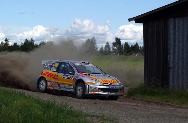 Sebastian Lindholm (FIN) with co-driver Timo Hautanen (FIN) Peugeot 206 WRC.FIA World Rally Championship, Rd9, Neste Rally Finland, Jyvaskyla, Finland. Day 2, 9 August 2003.DIGITAL IMAGE