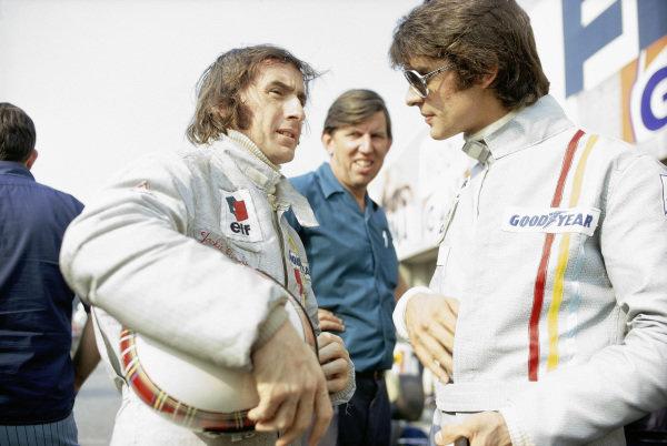 Jackie Stewart talks with team mate Francois Cevert and team boss Ken Tyrrell.