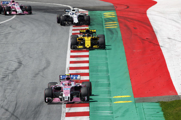 Esteban Ocon, Force India VJM11 Mercedes, leads Carlos Sainz Jr., Renault Sport F1 Team R.S. 18, Lance Stroll, Williams FW41 Mercedes, and Sergio Perez, Force India VJM11 Mercedes.