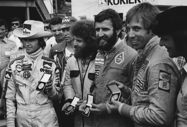 Osterreichring, Zeltweg, Austria. 13th - 15th August 1976.  Arturo Merzario, a representative of Guy Edwards, Harald Ertl and Brett Lunger receive medals for saving Niki Lauda from his near fatal crash at Nurburgring, portrait.  World Copyright: LAT Photographic. Ref: 8983 - 9A.