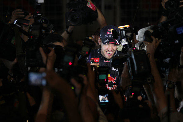 Buddh International Circuit, New Delhi, India. Sunday 27th October 2013. Sebastian Vettel, Red Bull Racing, 1st position, celebrates victory in the race and the Championship. World Copyright: Andy Hone/LAT Photographic. ref: Digital Image HONY0143