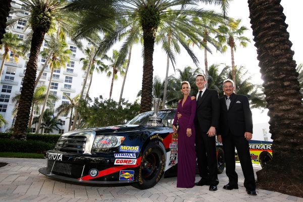 18 November, 2013, Miami Beach, Florida, USA Kyle and Samantha Busch with Rick Ren © 2013, Michael L. Levitt LAT Photo USA