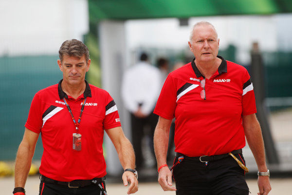 Silverstone Circuit, Northamptonshire, England. Sunday 5 July 2015. Greame Lowdon, President and Sporting Director, Manor F1, and John Booth, Team Principal, Manor F1, in the Paddock. World Copyright: Andrew Ferraro/LAT Photographic ref: Digital Image _FER9151