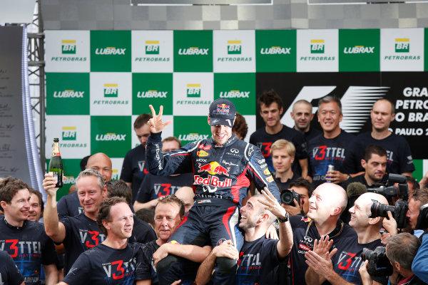 Interlagos, Sao Paulo, Brazil. Sunday 25th November 2012. 2012 World Champion Sebastian Vettel, Red Bull RB8 Renault, celebrates with the Red Bull team. World Copyright:Charles Coates/LAT Photographic ref: Digital Image _N7T8283