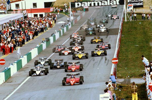 Osterreichring, Austria.12-14 August 1983.Patrick Tambay (Ferrari 126C3) leads Nelson Piquet (Brabham BT52B BMW), Rene Arnoux (Ferrari 126C3), Nigel Mansell (Lotus 94T Renault) and Riccardo Patrese (Brabham BT52B BMW) at the start. Ref-83 AUT 07.World Copyright - LAT Photographic