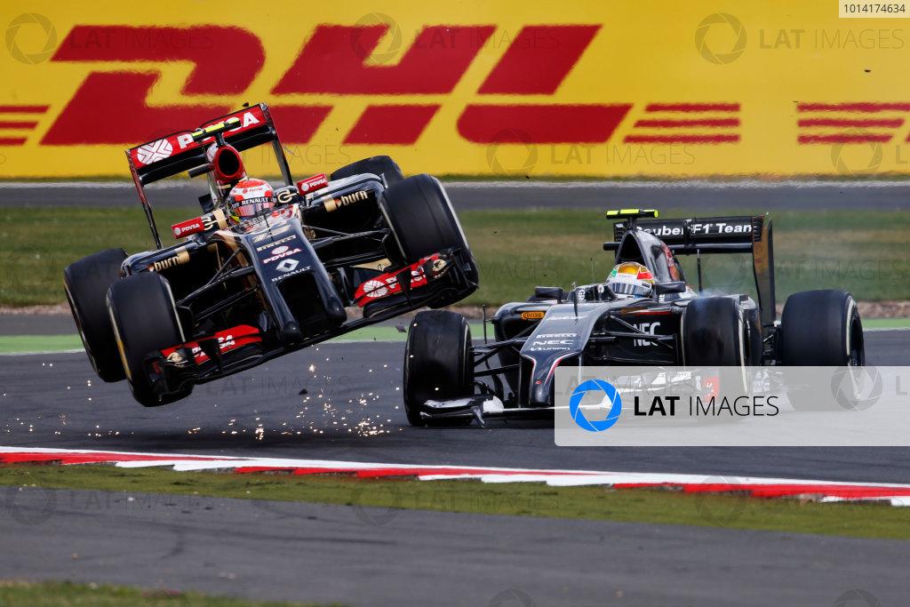 Silverstone, Northamptonshire, England. Sunday 6 July 2014. Pastor Maldonado, Lotus F1 and Esteban Gutierrez, Sauber C33 Ferrari collide on track. World Copyright: Charles Coates/LAT Photographic. ref: Digital Image _J5R8719