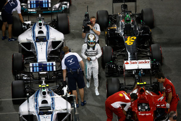 Yas Marina Circuit, Abu Dhabi, United Arab Emirates. Saturday 22 November 2014. Lewis Hamilton, Mercedes AMG, arrives in Parc Ferme after Qualifying. World Copyright: Charles Coates/LAT Photographic. ref: Digital Image _J5R5295