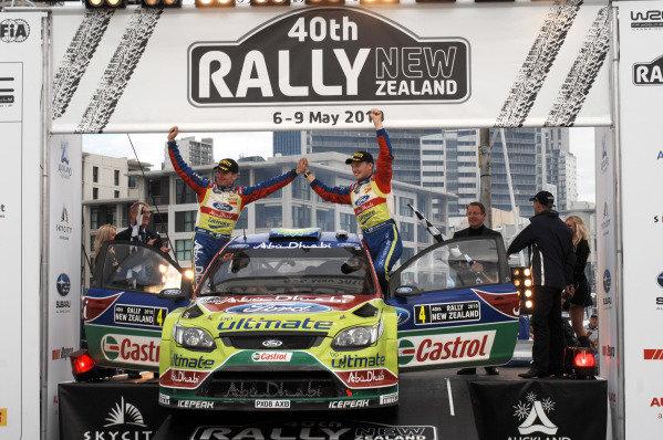 Jari-Matti Latvala (FIN) and Miikka Antilla (FIN) celebrate their victory on the podium. Rally New Zealand, Auckland, New Zealand, Day Three, 9 May 2010.