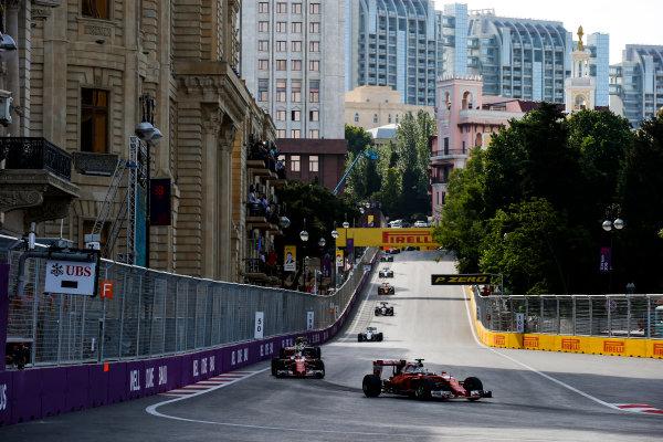 Baku City Circuit, Baku, Azerbaijan. Sunday 19 June 2016. Sebastian Vettel, Ferrari SF16-H leads Kimi Raikkonen, Ferrari SF16-H at the start of the race World Copyright: Sam Bloxham/LAT Photographic ref: Digital Image _SLA3482