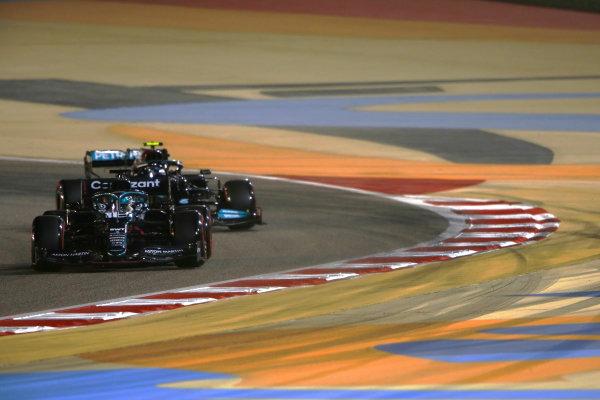Lance Stroll, Aston Martin AMR21, leads Valtteri Bottas, Mercedes W12