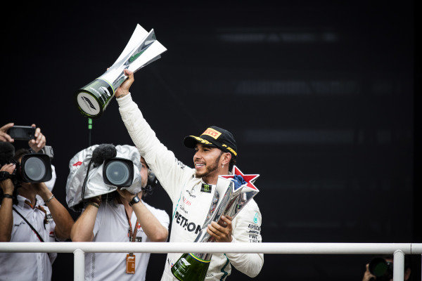Lewis Hamilton, Mercedes AMG F1, 1st position, with the winners trophies