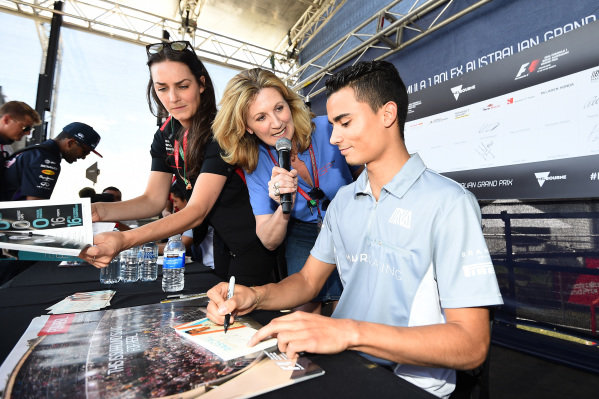 Louise Goodman (GBR) Goodman Media with Pascal Wehrlein (GER) Manor Racing at the autograph session at Formula One World Championship, Rd1, Australian Grand Prix, Preparations, Albert Park, Melbourne, Australia, Thursday 17 March 2016.