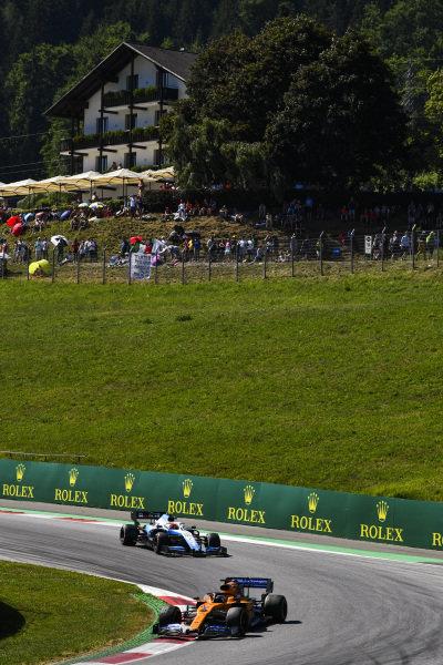 Carlos Sainz Jr., McLaren MCL34, leads Robert Kubica, Williams FW42