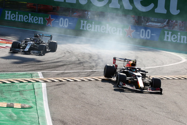 Alexander Albon, Red Bull Racing RB16, misses the chicane as Lewis Hamilton, Mercedes F1 W11 EQ Performance, approaches