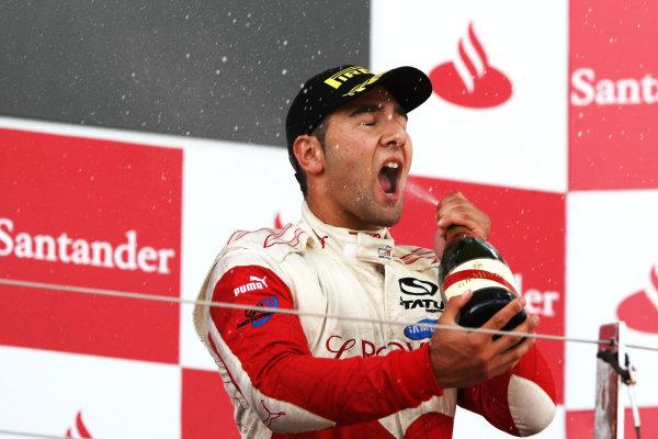 Round 4.Silverstone, England. 11th July 2010. Sunday Race. Daniel Morad, (CAN, Status Grand Prix) celebrates victory on the podium. Portrait.  World Copyright: Jakob Ebrey/GP3 Media Service.  Digital Image MKO_8632