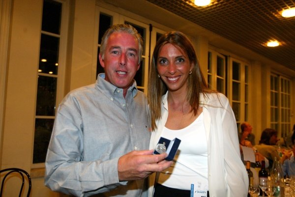 (L-R) British photographer Keith Sutton (GBR) and Nani Rodrguez, Gonzalo Rodriguez's sister at the F3000 awards.Italian Grand Prix, Monza, Italy. 13 September 2002.DIGITAL IMAGE