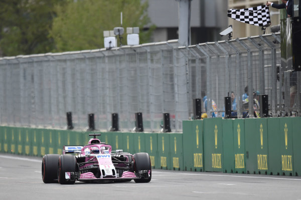 Sergio Perez (MEX) Force India VJM11 takes the chequered flag